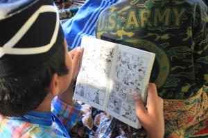 Salahseorang Peserta Gerakan Kampung Membaca Episode 34, Memilih Komik sebagai Bacaan